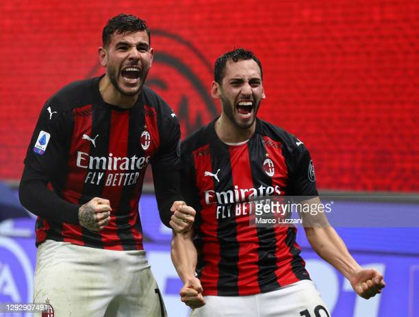 Theo Hernandez of AC Milan celebrates his goal with his team-mate Hakan Calhanoglu during the Serie A match between AC Milan and SS Lazio at Stadio...