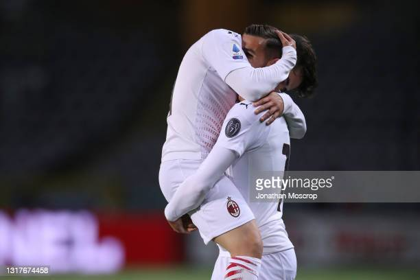 Theo Hernandez of AC Milan celebrates with team mate Brahim Diaz after scoring to give the side a 1-0 lead during the Serie A match between Torino FC...
