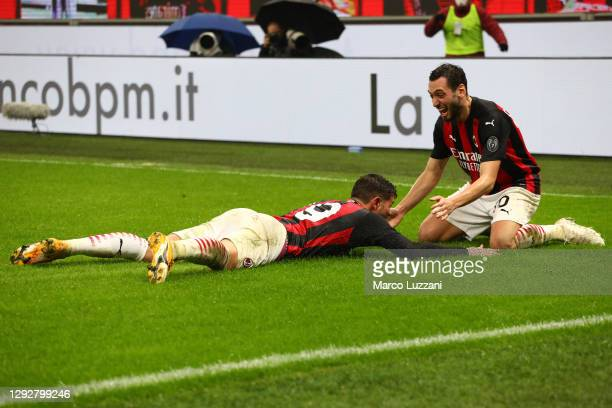 Theo Hernandez of AC Milan celebrates with team mate Hakan Calhanoglu after scoring their sides third goal during the Serie A match between AC Milan...