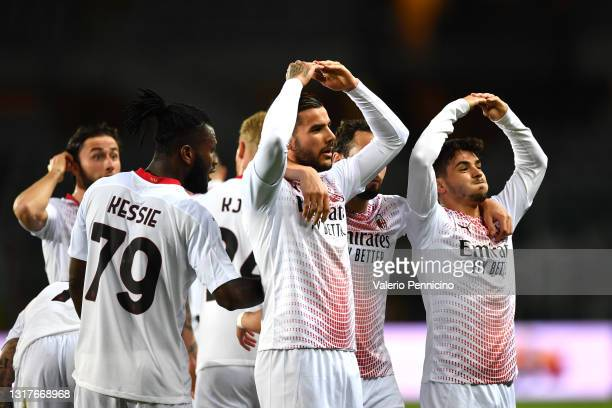 Theo Hernandez of A.C. Milan celebrates with team mates after scoring their side's first goal during the Serie A match between Torino FC and AC Milan...