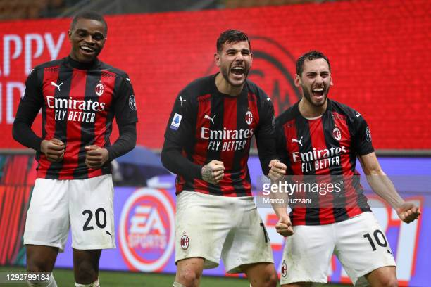 Theo Hernandez of AC Milan celebrates with team mates Pierre Kalulu and Hakan Calhanoglu after scoring their sides third goal during the Serie A...
