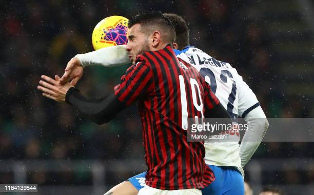 Theo Hernandez of AC Milan competes for the ball with Giovanni Di Lorenzo of SSC Napoli during the Serie A match between AC Milan and SSC Napoli at...