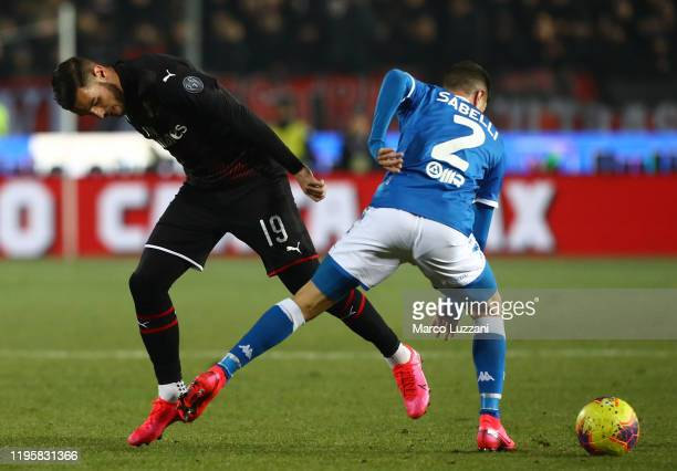 Theo Hernandez of AC Milan competes for the ball with Stefano Sabelli of Brescia Calcio during the Serie A match between Brescia Calcio and AC Milan...