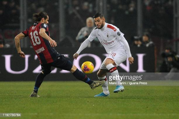 Theo Hernandez of AC Milan competes the ball with Andrea Poli of Bologna FC during the Serie A match between Bologna FC and AC Milan at Stadio Renato...