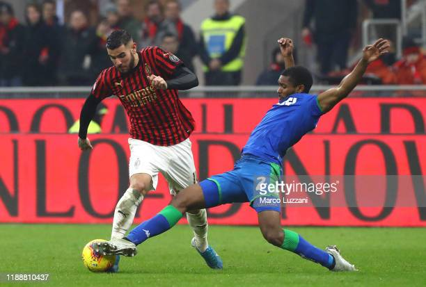 Theo Hernandez of AC Milan is challenged by Marlon of US Sassuolo during the Serie A match between AC Milan and US Sassuolo at Stadio Giuseppe Meazza...