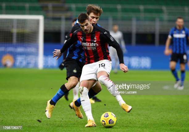 Theo Hernandez of AC Milan is challenged by Nicolo Barella of FC Internazionale during the Coppa Italia match between FC Internazionale and AC Milan...