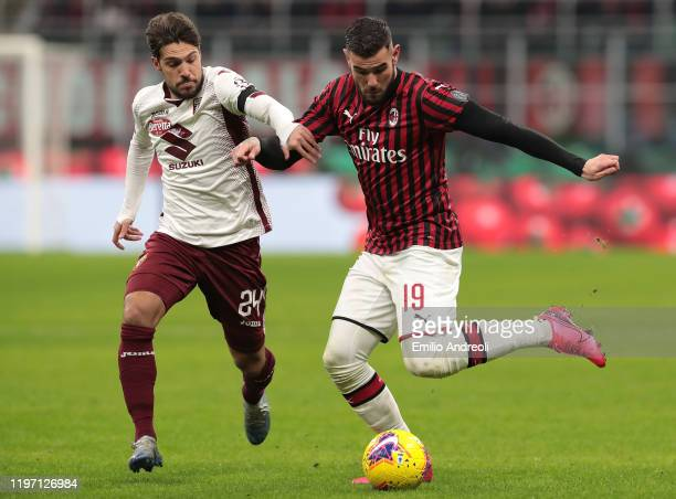 Theo Hernandez of AC Milan is challenged by Simone Verdi of Torino FC during the Coppa Italia Quarter Final match between AC Milan and Torino at San...