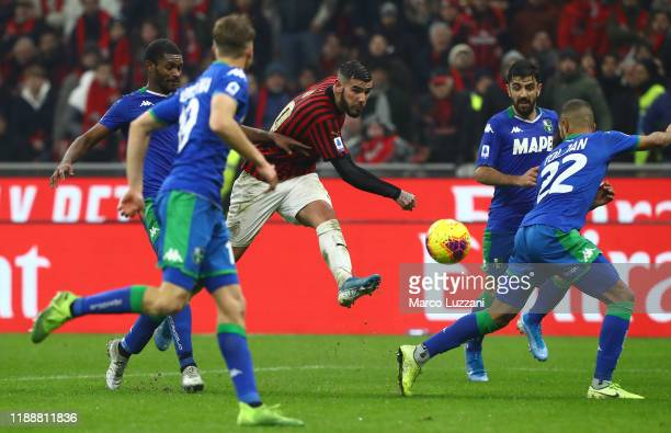 Theo Hernandez of AC Milan kicks a ball during the Serie A match between AC Milan and US Sassuolo at Stadio Giuseppe Meazza on December 15 2019 in...