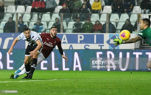 Theo Hernandez of AC Milan scores the opening goal during the Serie A match between Parma Calcio and AC Milan at Stadio Ennio Tardini on December 1...