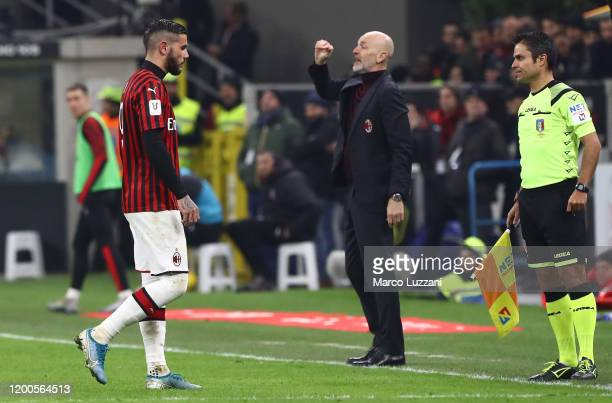 Theo Hernandez of AC Milan walks off after getting a red card during the Coppa Italia Semi Final match between AC Milan and Juventus at Stadio...