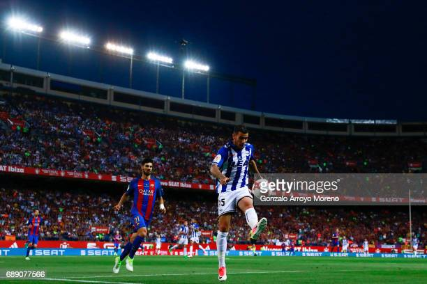 Theo Hernandez of Deportivo Alaves competes for the ball with Andre Gomes of FC Barcelona during the Copa Del Rey Final between FC Barcelona and...
