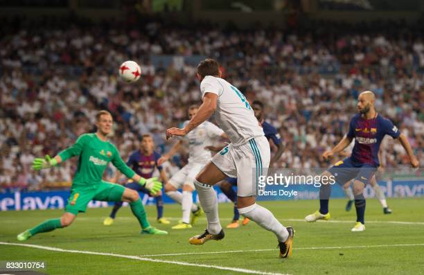 Theo Hernandez of Real Madrid CF centers past MarcAndre ter Stegen of FC Barcelona during the Supercopa de Espana Final 2nd Leg match between Real...