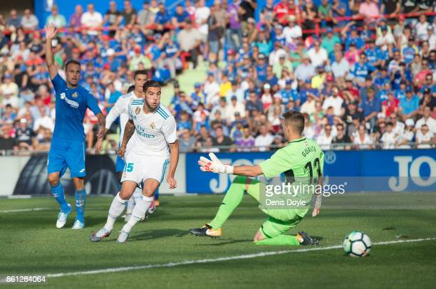 Theo Hernandez of Real Madrid CF shoots past Vicente Guaita of Getafe during the La Liga match between Getafe and Real Madrid at Coliseum Alfonso...