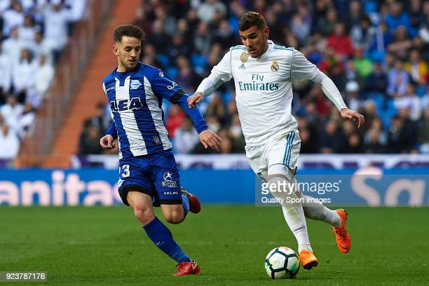 Theo Hernandez of Real Madrid competes for the ball with Alvaro Medran of Deportivo Alaves during the La Liga match between Real Madrid and Deportivo...