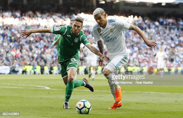 Theo Hernandez of Real Madrid competes for the ball with Joseba Zaldua of Leganes during the La Liga match between Real Madrid and Leganes at Estadio...