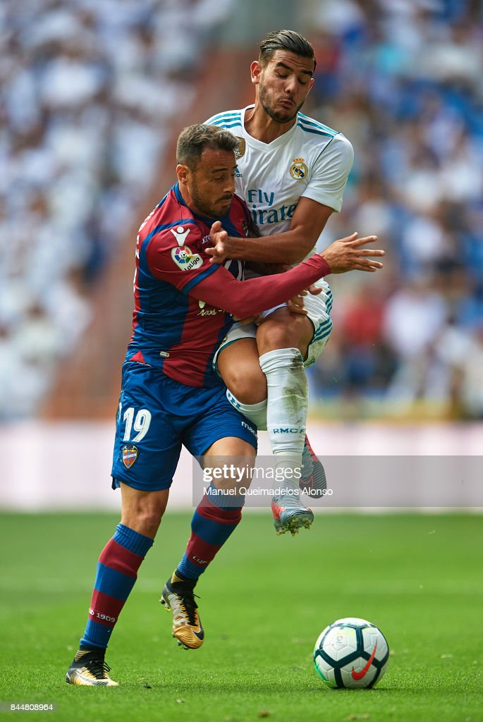 Theo Hernandez (R) of Real Madrid competes for the ball with Pedro Lopez of Levante during the La Liga match between Real Madrid and Levante at Estadio Santiago Bernabeu on September 9, 2017 in Madrid, Spain.