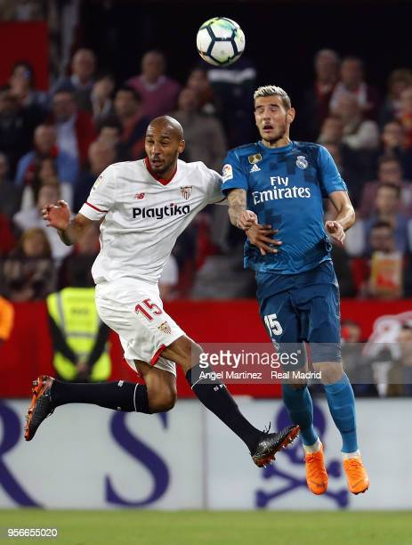 Theo Hernandez of Real Madrid competes for the ball with Steven NÕZonzi of Sevilla during the La Liga match between Sevilla and Real Madrid at...