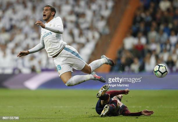 Theo Hernandez of Real Madrid is tackled by Cristian Rivera of Eibar during the La Liga match between Real Madrid and Eibar at Estadio Santiago...