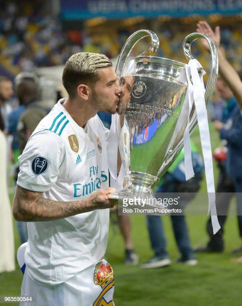 Theo Hernandez of Real Madrid kisses the trophy after the UEFA Champions League Final between Real Madrid and Liverpool at NSC Olimpiyskiy Stadium on...