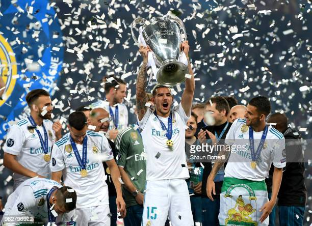 Theo Hernandez of Real Madrid lifts The UEFA Champions League trophy following his sides victory in the UEFA Champions League Final between Real...