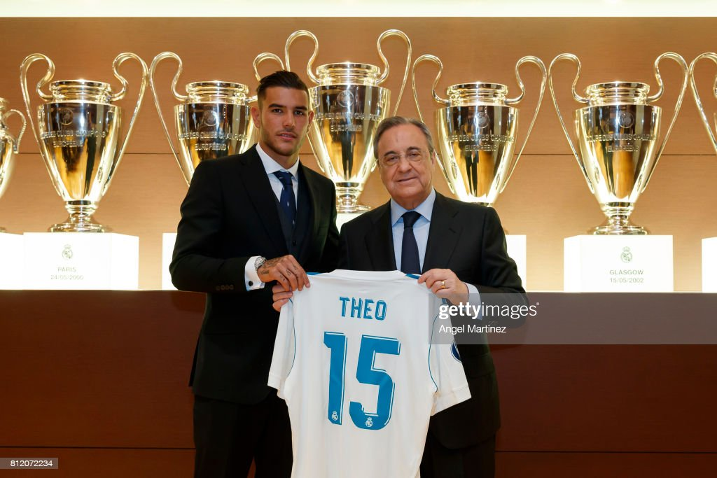 Theo Hernandez (L) of Real Madrid poses with President Florentino Perez during his official presentation at Estadio Santiago Bernabeu on July 10, 2017 in Madrid, Spain.