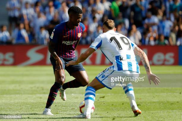 Theo Hernandez of Real Sociedad and Nelson Semedo of Barcelona battle for the ball during the La Liga match between Real Sociedad and FC Barcelona at...