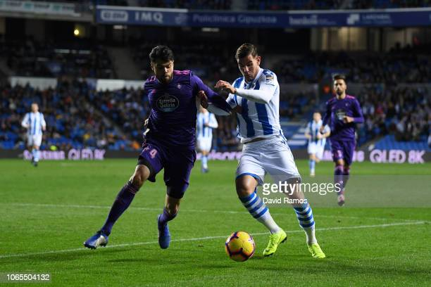 Theo Hernandez of Real Sociedad battles with Nestor Araujo of Celta Vigo during the La Liga match between Real Sociedad and RC Celta de Vigo at...