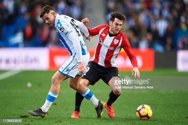 Theo Hernandez of Real Sociedad competes for the ball with Ibai Gomez of Athletic Club during the La Liga match between Real Sociedad and Athletic...
