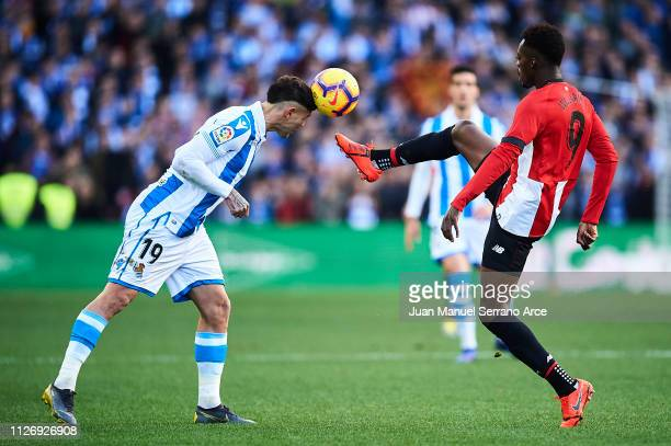 Theo Hernandez of Real Sociedad competes for the ball with Inaki Williams of Athletic Club during the La Liga match between Real Sociedad and...