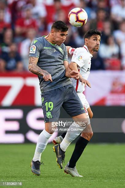 Theo Hernandez of Real Sociedad competes for the ball with Jesus Navas of Sevilla FC during the La Liga match between Sevilla FC and Real Sociedad at...