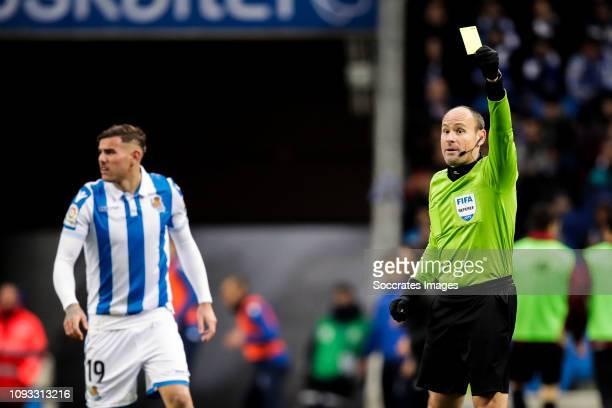 Theo Hernandez of Real Sociedad referee Mateu Lahoz during the La Liga Santander match between Real Sociedad v Athletic de Bilbao at the Estadio...
