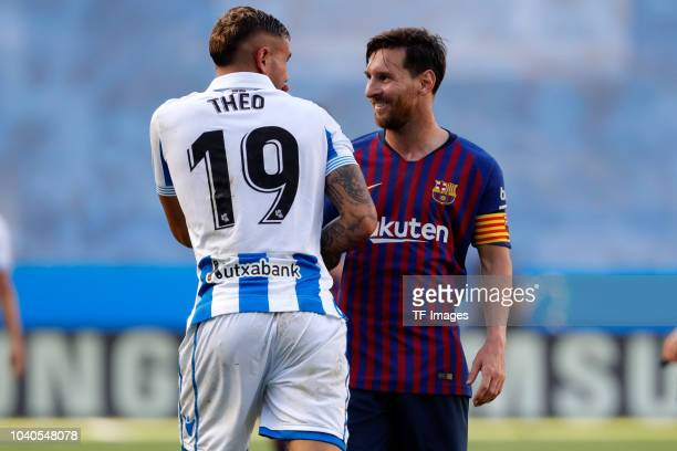Theo Hernandez of Real Sociedad speaks with Leo Messi of Barcelona during the La Liga match between Real Sociedad and FC Barcelona at Estadio Anoeta...