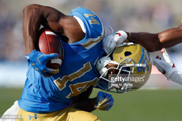 Theo Howard of the UCLA Bruins is tackled by the neck on a short pass play by Kendall Williamson of the Stanford Cardinal during the first half of a...