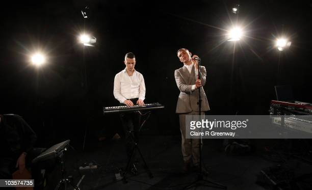 Theo Hutchcraft and Adam Anderson of band Hurts perform for a Biz Session recording in Wapping on August 23 2010 in London England