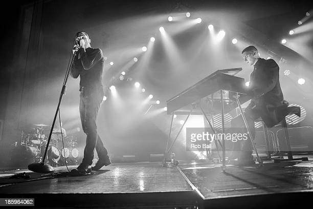 Theo Hutchcraft and Adam Anderson of Hurts performs on stage at the Troxy on October 26 2013 in London England