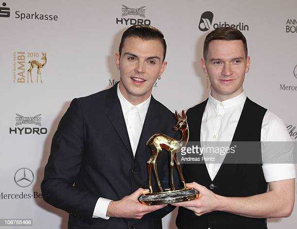 Theo Hutchcraft and Adam Anderson of Hurts pose with the Bambi award Shooting Star at the Bambi 2010 Award Winners Board at Filmpark Babelsberg on...
