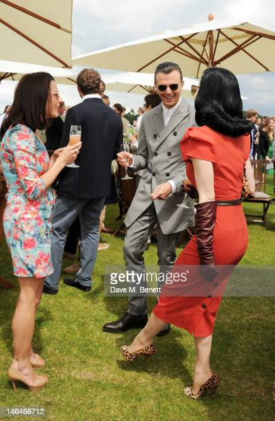 Theo Hutchcraft and Dita Von Teese attend the Cartier Queen's Cup Polo Day 2012 at Guards Polo Club on June 17 2012 in Egham England