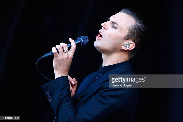 Theo Hutchcraft of Hurts performs live on the main stage during day two of the Isle of Wight Festival 2011 at Seaclose Park on June 11 2011 in...