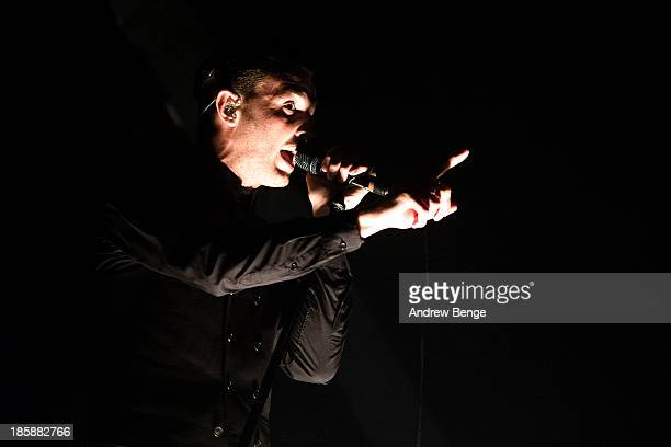 Theo Hutchcraft of Hurts performs on stage at Manchester Apollo on October 25 2013 in Manchester England