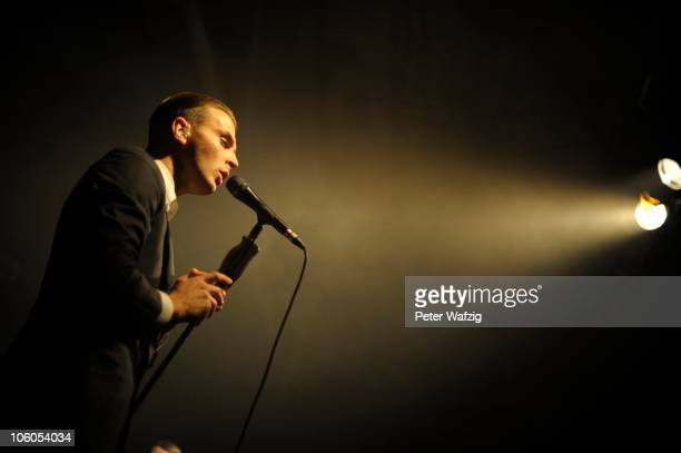 Theo Hutchcraft of Hurts performs on stage at the Essigfabrik on October 20 2010 in Cologne Germany