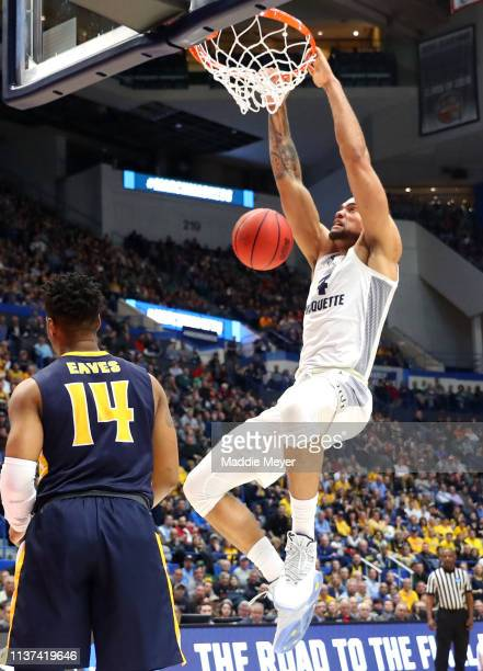 Theo John of the Marquette Golden Eagles dunks against the Murray State Racers during the first round game of the 2019 NCAA Men's Basketball...