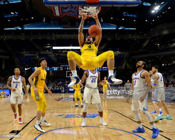 Theo John of the Marquette Golden Eagles reacts after dunking the ball against the DePaul Blue Demons at Wintrust Arena on February 12, 2019 in...
