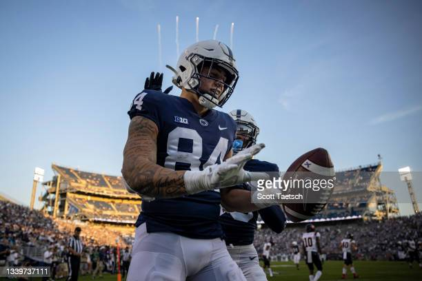 Theo Johnson of the Penn State Nittany Lions celebrates after scoring a touchdown against the Ball State Cardinals during the second half at Beaver...