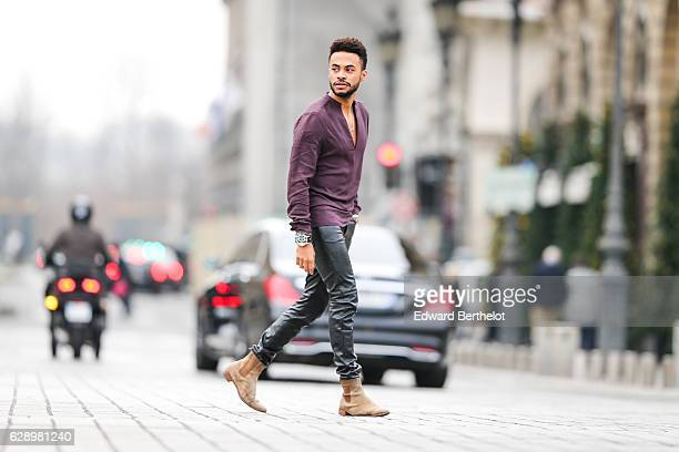Theo Kimbaloula fashion and life style blogger @theopvris is wearing an Asos purple shirt an Asos necklace CheapMonday leather pants and The Kooples...
