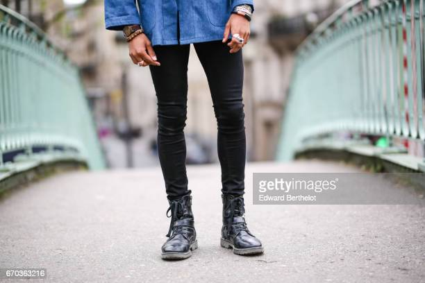 Theo Kimbaloula fashion blogger wears a Carubas blue Chinese jacket a Western Candy bandana Asos jeans and Asos boots on April 16 2017 in Paris France