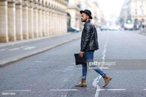Theo Kimbaloula fashion blogger wears a Sand Copenhagen black leather perfecto jacket a Baan Bag black clutch Asos blue denim jeans and The Kooples...