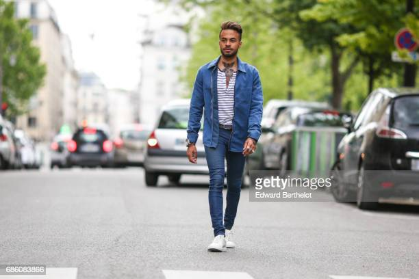 Theo Kimbaloula fashion blogger wears an HM striped top an HM blue denim jacket Asos blue denim jeans a belt and Agnes B shoes on May 13 2017 in...