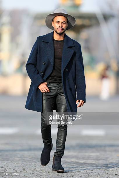 Theo Kimbaloula is wearing a Sand Copenhagen mesh tshirt The Kooples black jeans Keiro black shoes a Daniel Wellington watch a Saudade Paris bracelet...