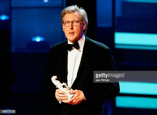 Theo Koll stands on stage at the Bavarian TV Price Blue Panther ceremony on June 3 2005 in Munich Germany Kaufman was honored during the annual award...