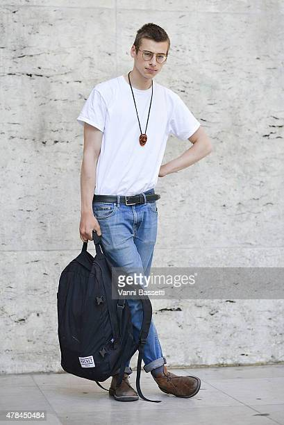 Theo Mouvras poses wearing a vintage outfit and Racket Paris backpack on June 25 2015 in Paris France